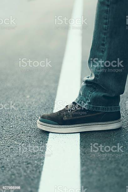 Male foot standing on the white line crossing line concept picture id627958998?b=1&k=6&m=627958998&s=612x612&h=dbe2p6n wmynnbjcafahvjqxedioupwnuabck2gfl9w=