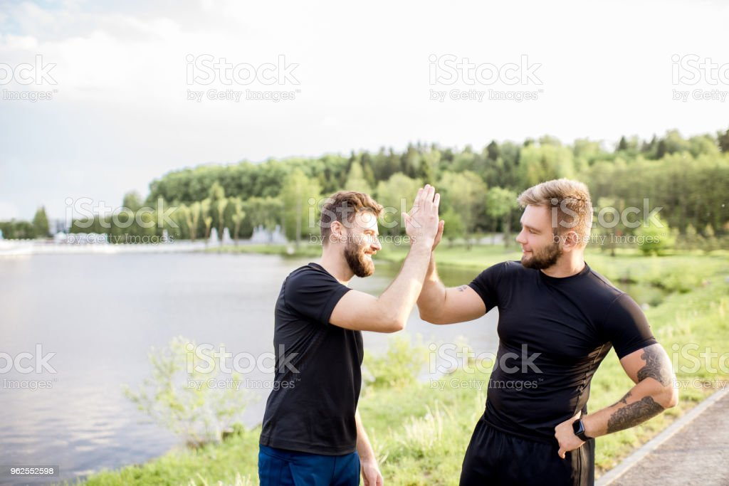 Male friends after the sports training outdoors - Royalty-free Adult Stock Photo