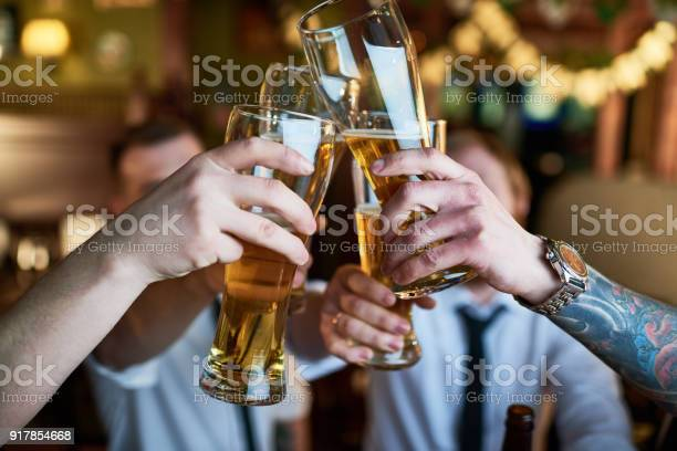 Male friends clinking glasses of craft beer picture id917854668?b=1&k=6&m=917854668&s=612x612&h=lxhmuou3bpsfi3ra7baaf9uj lxjy2xxv r4mh8f5bi=