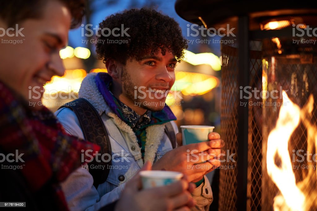 Mulled Wine Christmas Market.Male Friends Drinking Mulled Wine At Christmas Market Stock Photo Download Image Now