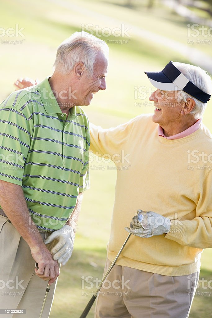 Male Friends Enjoying A Game Of Golf royalty-free stock photo