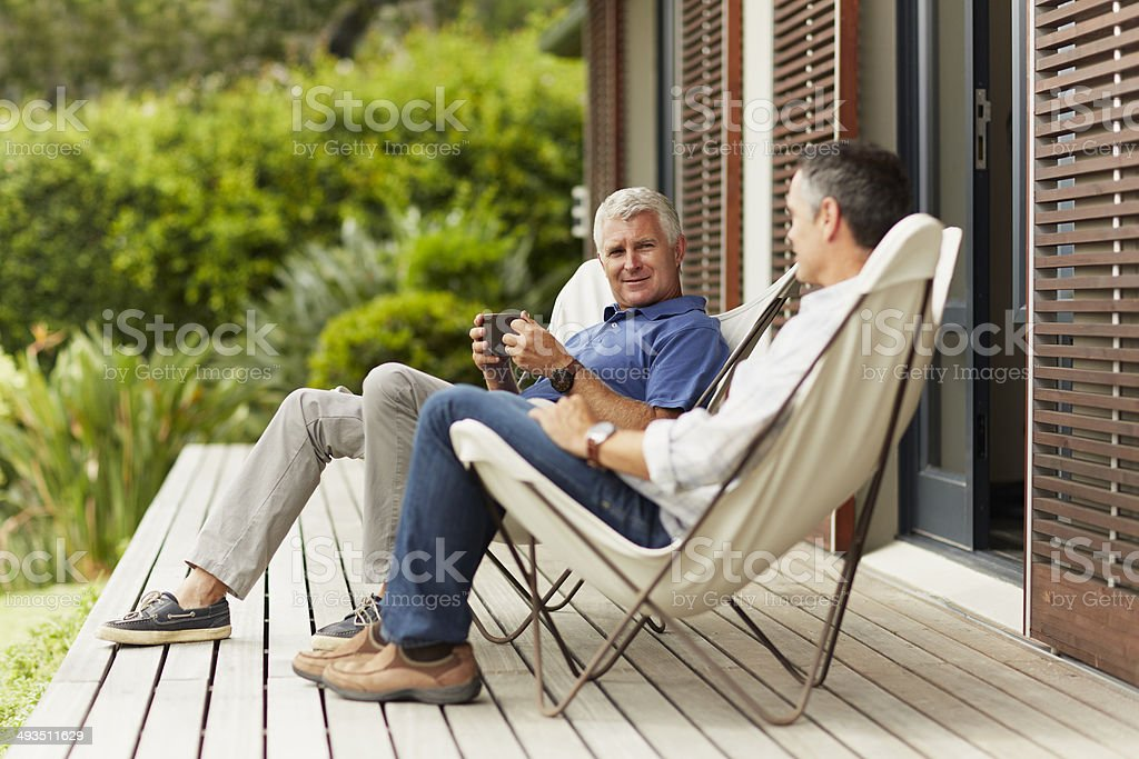 Male friends spending leisure time at yard stock photo