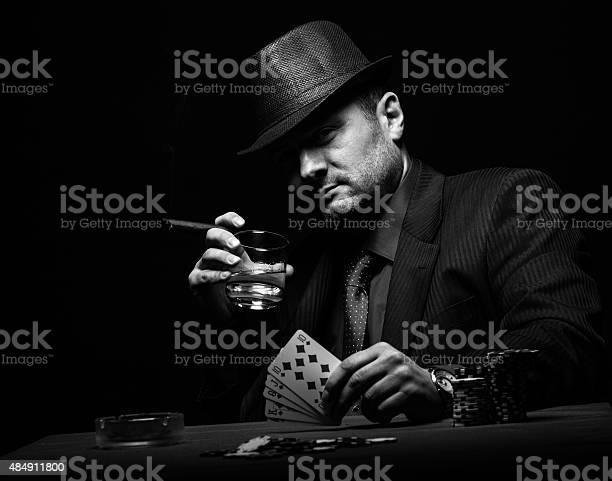Male gambler playing poker picture id484911800?b=1&k=6&m=484911800&s=612x612&h=os4ss au2eu0t qglzv5w8i9ifwyqefnkciu7co2nbu=