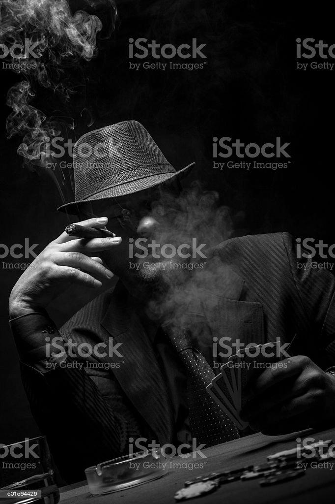 Male gambler playing poker. stock photo