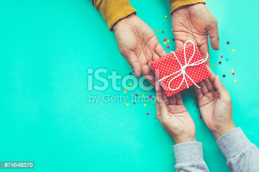 istock Male gives a gift to female with copy space 874548370