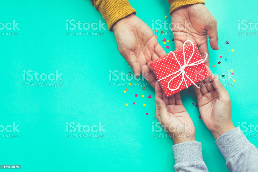 Male gives a gift to female with copy space stock photo