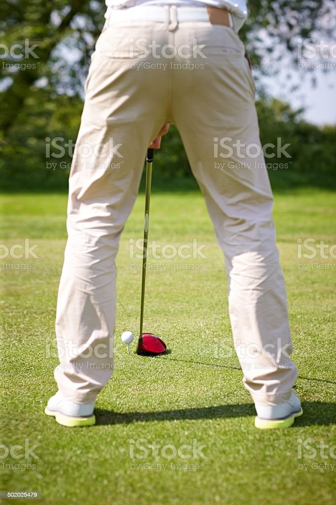 Male golfer getting ready to tee off golf ball royalty-free stock photo