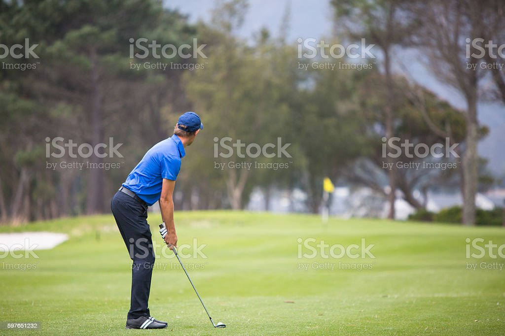 Male golfer hitting his t-shot stock photo