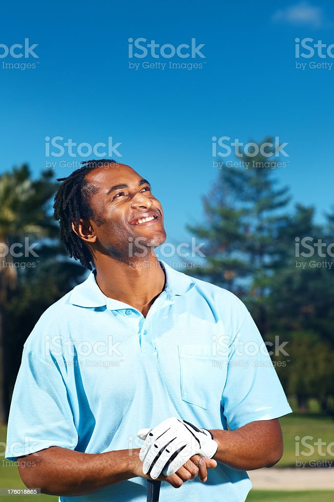 Male golfer looking towards copyspace royalty-free stock photo