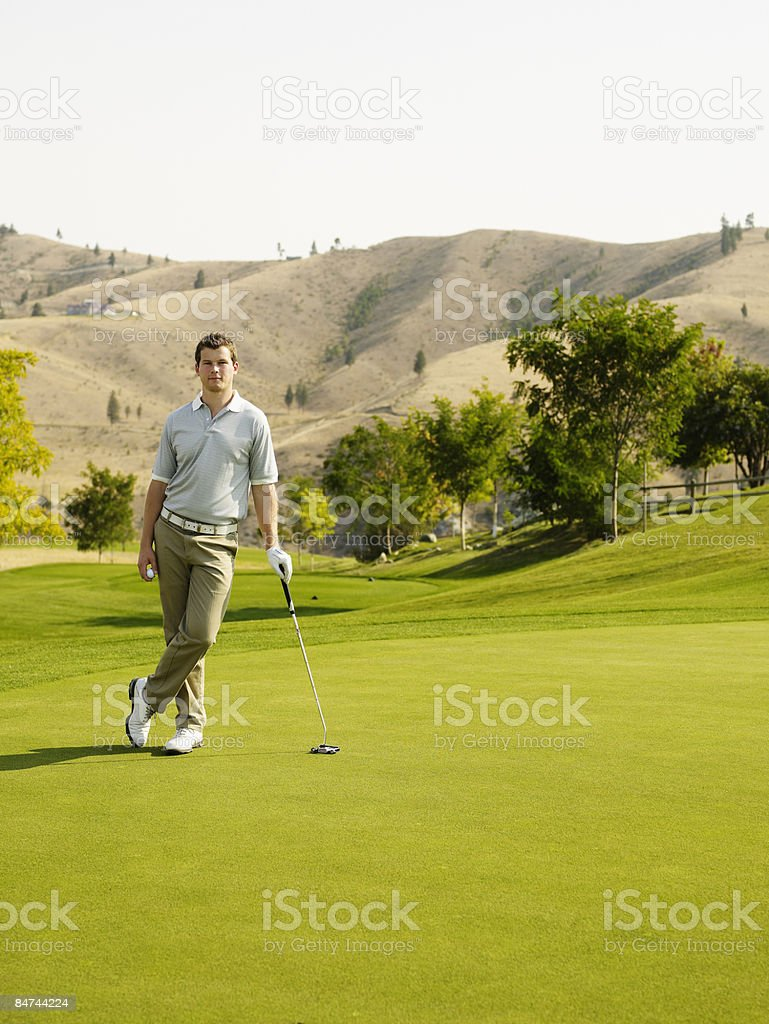 Male golfer on putting green royalty-free stock photo
