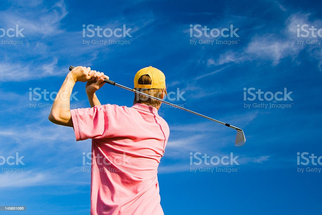 Male golfer on summer blue sky background royalty-free stock photo