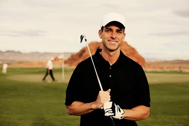männliche-golfspieler - schiebermütze stock-fotos und bilder
