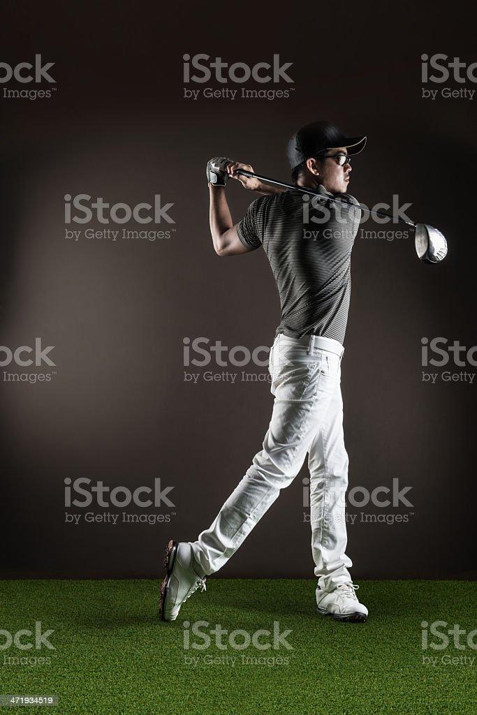 Male golfer portrait mid swing stock photo