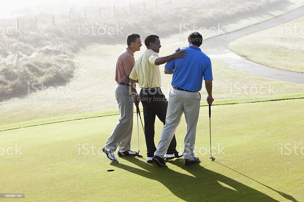 Male golfers bonding stock photo