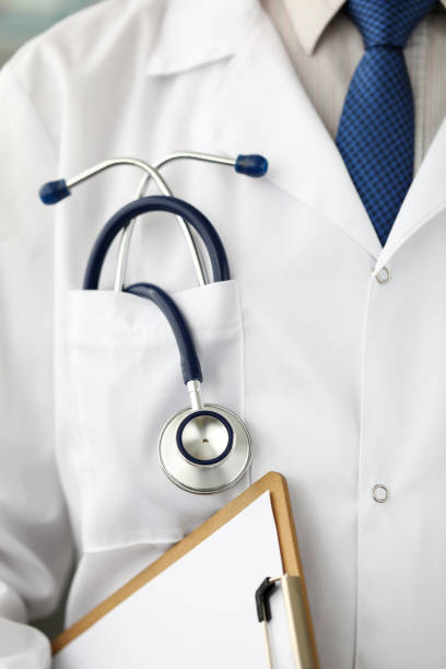 Male GP pocket with stethoscope lying in it stock photo