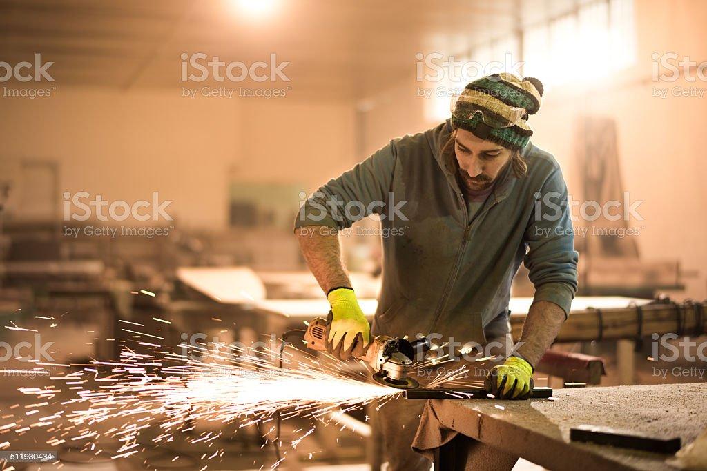Male grinder in workshop stock photo