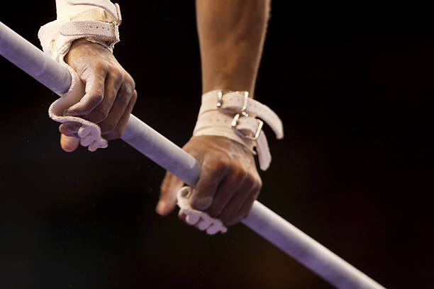 male gymnast's hands on high bar - horizontal bar stock photos and pictures