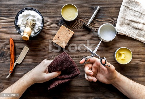 istock male hairdressing concept with barbershop hands on table background top view 661705018