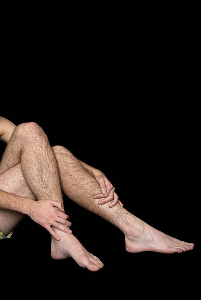 Male hairy legs and arms stock photo