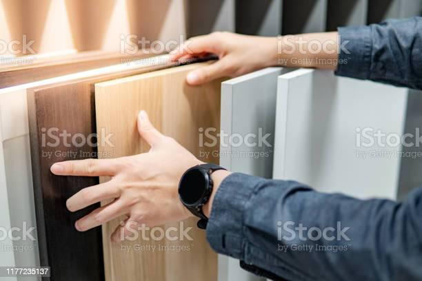 Male hand choosing cabinet or countertop materials picture id1177235137?b=1&k=6&m=1177235137&s=612x612&h=iejkpw3ha5sijopx1vmklwm6nqbkum4ryeqeq3wiik8=