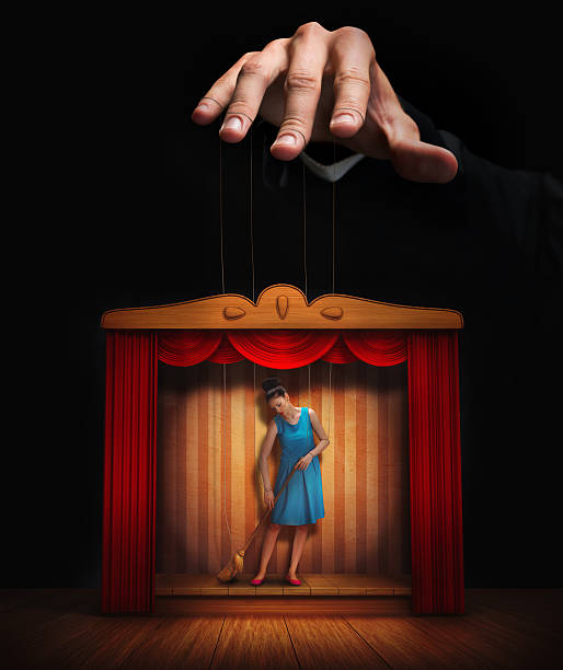 Male hand controlling a small woman puppet Male hand controlling a small woman puppet puppet stock pictures, royalty-free photos & images