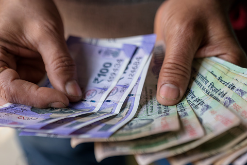 istock Male Hand Counting Cash 1130639007
