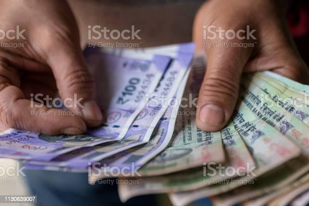 Male hand counting cash picture id1130639007?b=1&k=6&m=1130639007&s=612x612&h=uztkfekddsgozujqznaupsksguinf2ah2afjaejdopw=