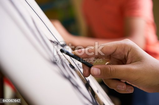istock Male Hand Drawing Young Man Sketching Artist Training At School 642062642