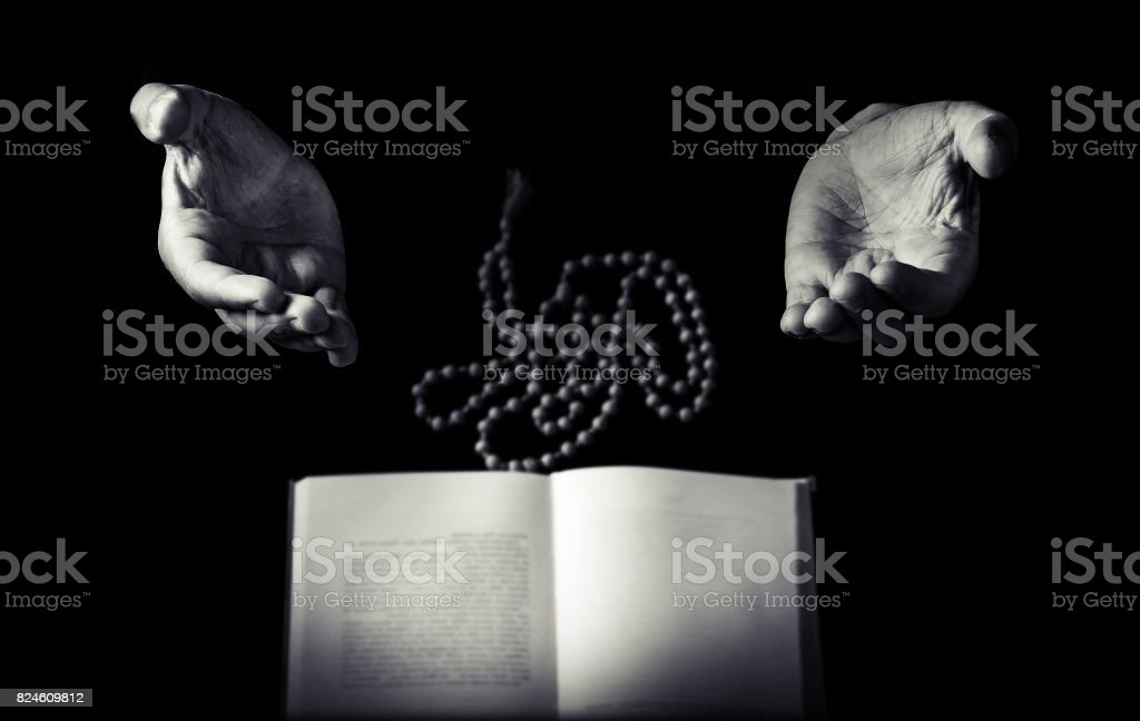 Male hand folded in prayer stock photo