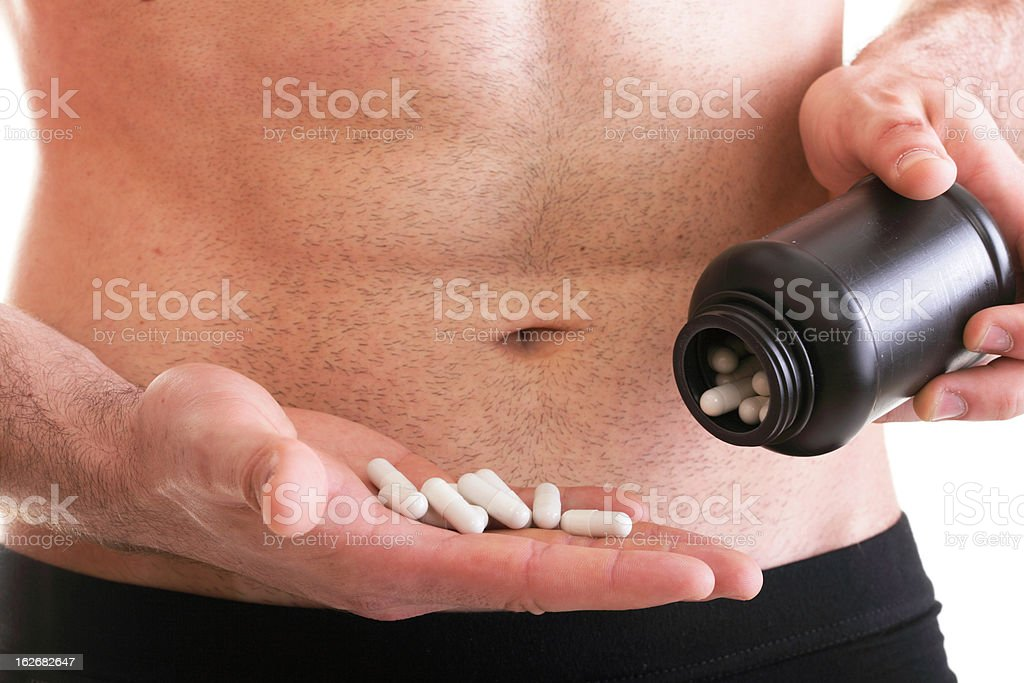 male hand full of pills or tablets box with supplements royalty-free stock photo