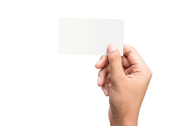 Male hand holding a blank business card on a pure white background for text or design. Blank credit card templates for contact or use in business. ( Clipping path ) stock photo