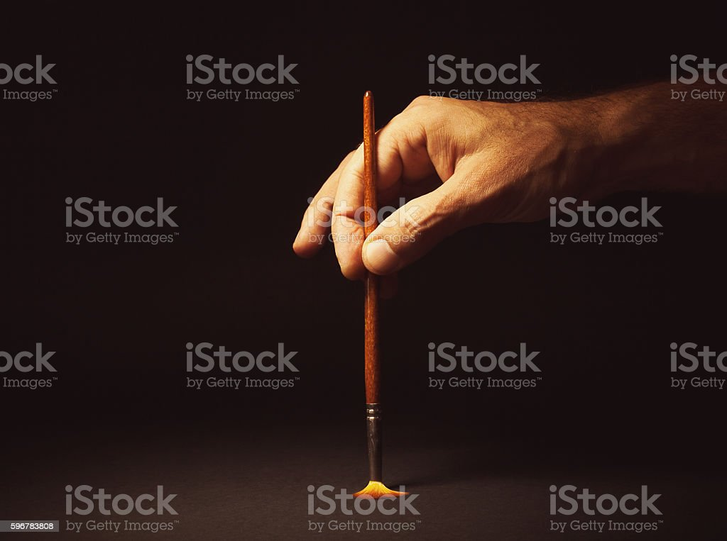 Male Hand Holding a Brush stock photo