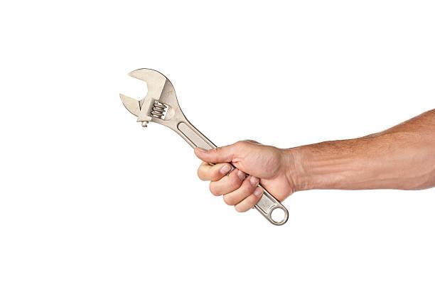 masculino mão segurando uma chave de crescent - chave de porcas - fotografias e filmes do acervo