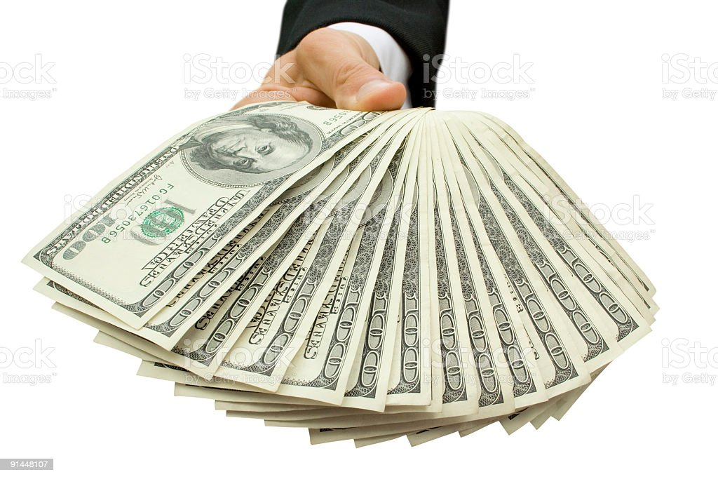 A male hand holding a fan of $100 dollar bills royalty-free stock photo