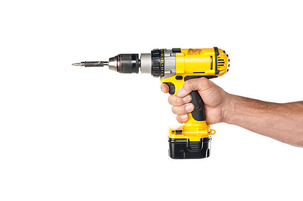 "Male Hand Holding A Powere Drill ""Male handyman's hand holding an electric power drill, shot against a white background.Take a look at our lightbox's of other related images."" drill stock pictures, royalty-free photos & images"