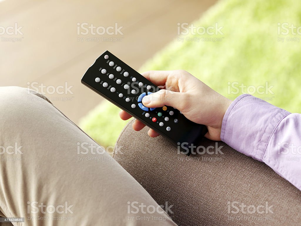 Male hand holding a remote control royalty-free stock photo