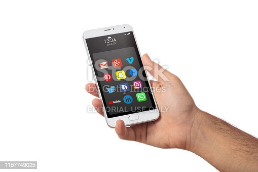 istock Male hand holding a smartphone with apps icons isolated against white color background 1157749025