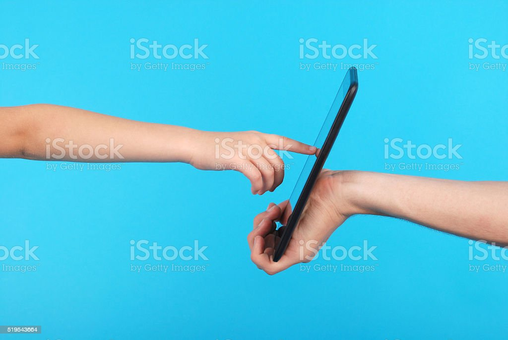 Male hand holding a touchscreen stock photo