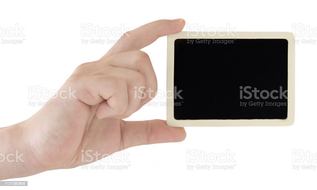 Male hand holding black board  isolated on white background stock photo