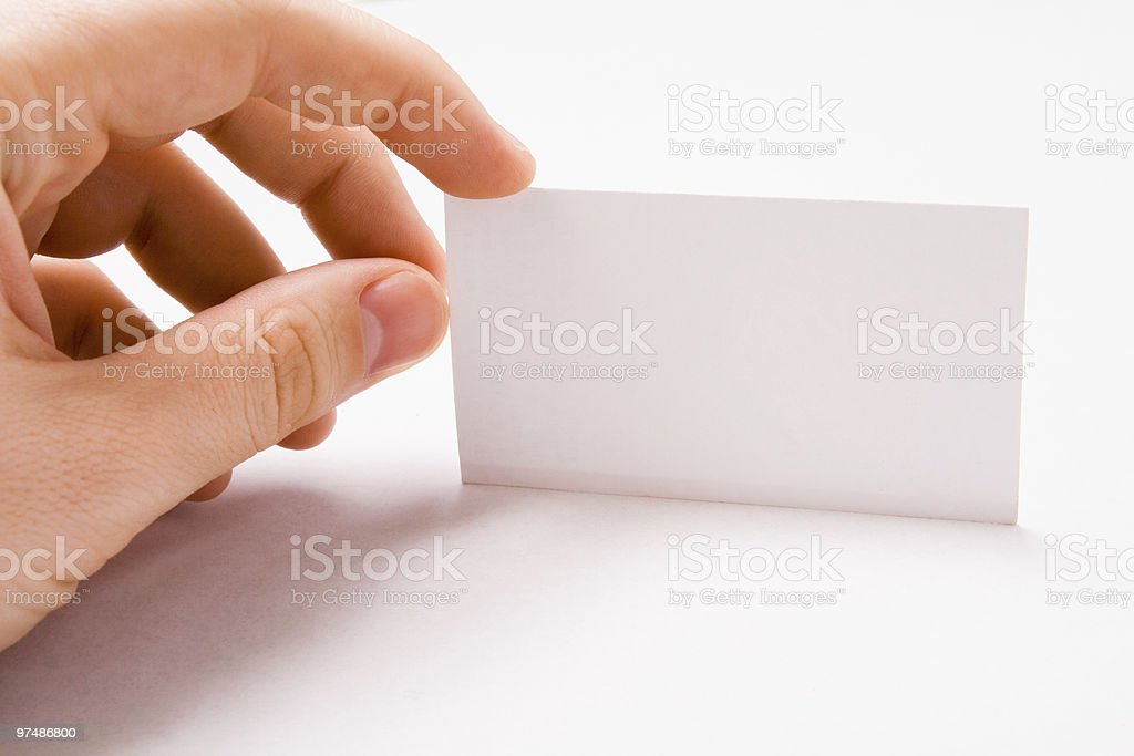 Male hand holding blank business card royalty-free stock photo