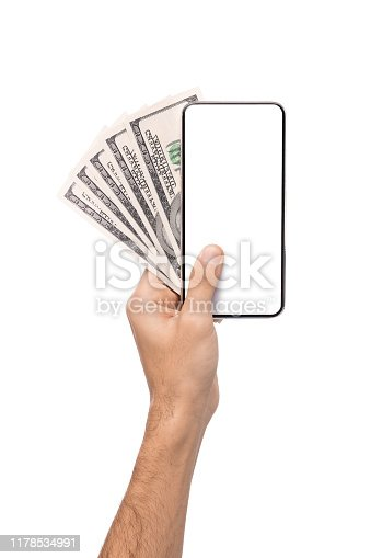 Male hand holding blank cellphone and bunch of USD banknotes, isolated on white background