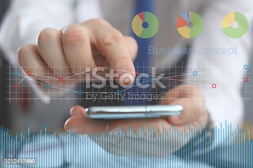 655652514 istock photo Male hand holding cellphone using some mobile business application 1212417490
