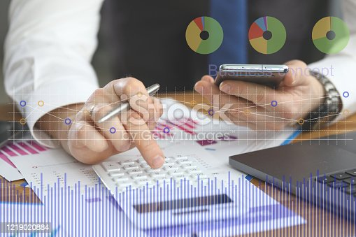 655652514 istock photo Male hand holding cellphone using some mobile business application 1219020884