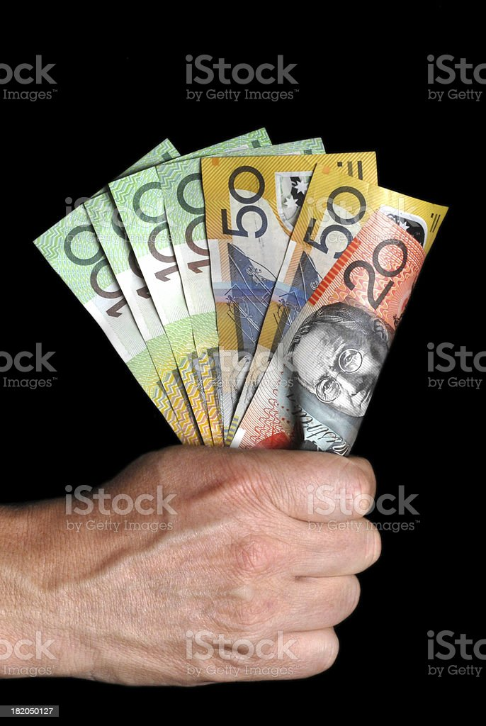 Male hand holding fist of Australian currency royalty-free stock photo