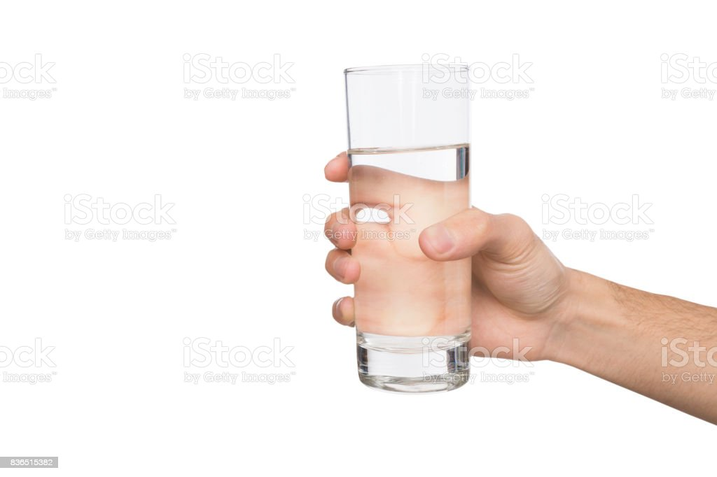 Male hand holding glass of water isolated on white - foto stock