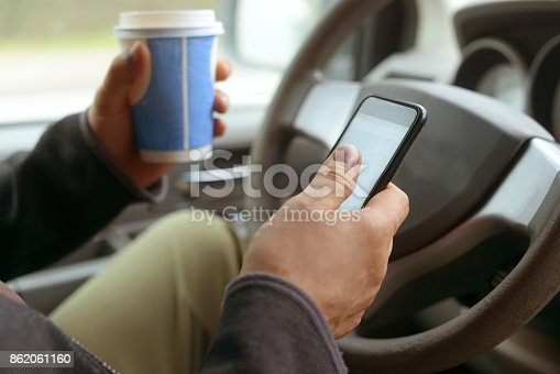 istock Male hand holding mobile phone 862061160