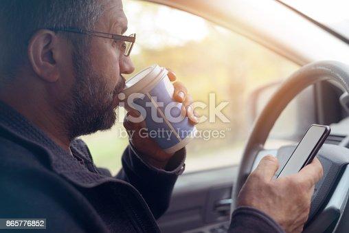 istock Male hand holding mobile phone 865776852