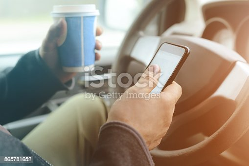 istock Male hand holding mobile phone 865781652