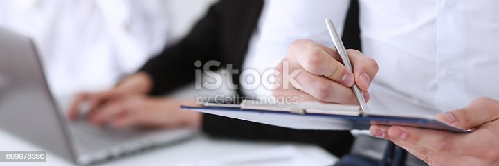 istock Male hand holding silver pen ready 869678380