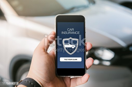 istock Male hand holding smartphone with car insurance concept. 1175506313